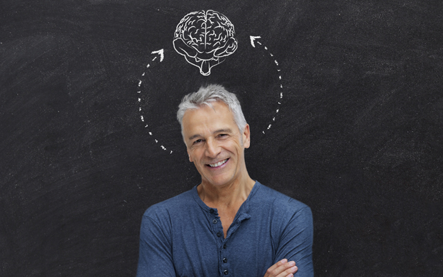 cubex hearing brain mature man in front of blackboard