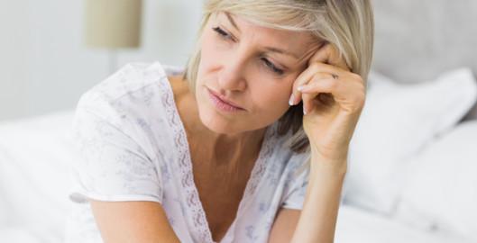 cubex tinnitus mature woman sat on bed