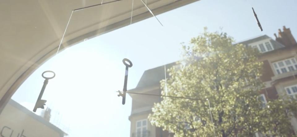Keys dangling in sun - cubex clinic front window
