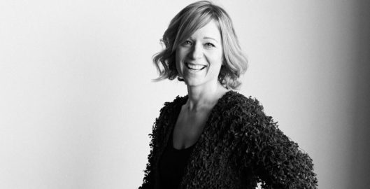 Ruth Penfold VP at Onfido - black and white shot smiling